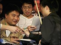 Ding Junhui signs autographs