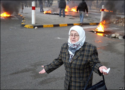 A woman gestures as she walks through the streets of Beirut