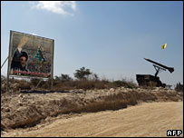 A billboard of Hezbollah chief Hassan Nasrallah and a model of a Katyusha rocket launcher in southern Lebanon