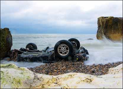 Upturned car on beach