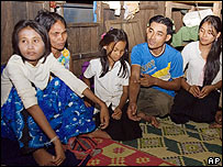 Woman believed to be Rochom P'ngieng (left) with the family that claims her