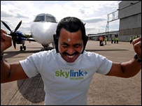 Manjit Sing pulling aeroplane with his ears