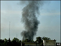 Smoke rises above the Red Mosque