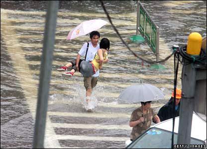 A man carries a woman across a flooded street in Nanjing of Jiangsu province.