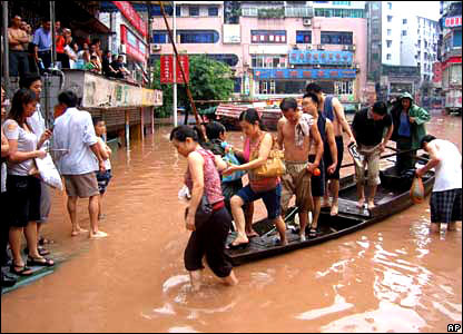 Residents negotiate the floods by boat in China.