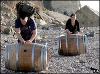 Scavengers rolling barrels