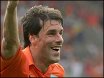 Ruud van Nistelrooy celebrates scoring for Holland