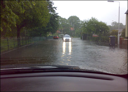 Cars driving through floodwater