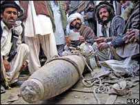 Unexploded bomb at scene of air raid in Kot Kalay