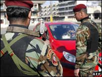Iraqi police commandos man a checkpoint in central Baghdad, 19 January 2007.