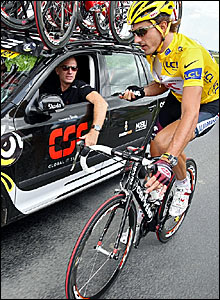 Fabian Cancellara (right) rides with his team car