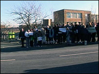 Protesters outside the school