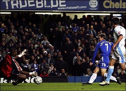 Wycombe goalkeeper Ricardo Batista (left) fails to stop Andriy Shevchenko's shot