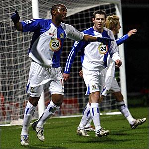 Benni McCarthy (left) wheels away in celebration after scoring Blackburn's equaliser