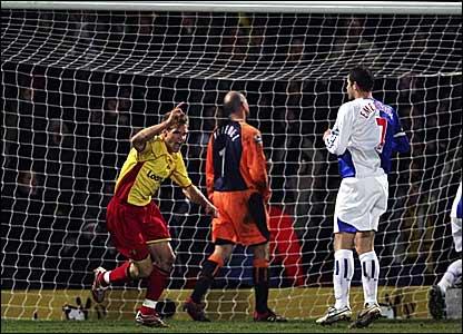 Jay DeMerit (left) celebrates scoring Watford's winner against Blackburn