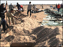 Iraqi volunteers bury bodies in November - 176 bodies of victims of recent sectarian violence were bought for the funeral