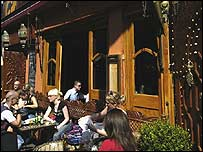 People sitting outside of a pub