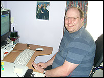 Doug Paulley sitting at his computer