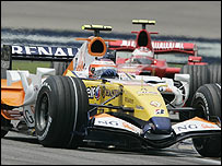 Heikki Kovalainen's Renault leads the Ferrari of Kimi Raikkonen during the US Grand Prix