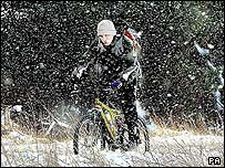 Cyclist in the snow on the North Yorkshire Moors