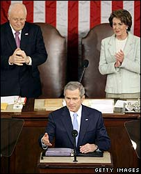 President Bush with Vice-President Dick Cheney and Speaker Nancy Pelosi behind him