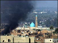 Smoke rises over Baghdad after clashes in Sunni area