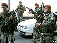 Lebanese soldiers shout at opposition supporters during Tuesday's strike