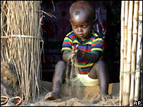 A child plays with sand in Daruga, on the outskirts of Abuja, Nigeria