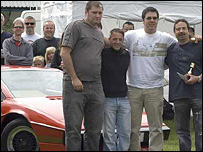 Simon Pritchard (left) standing next to three of the people who worked on the car