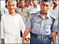 Monoranjan Roy with police officer