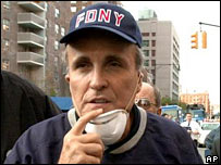 Rudy Giuliani tours the site of the World Trade Center disaster on 12 September 2001