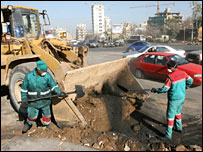 Street sweepers remove debris from the roads in Beirut