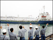 South Koreans wave off the first shipment of energy aid to the North, 12th July