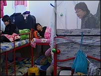 Chinese workers in dormitory