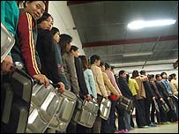 Chinese workers in Romania queue for food