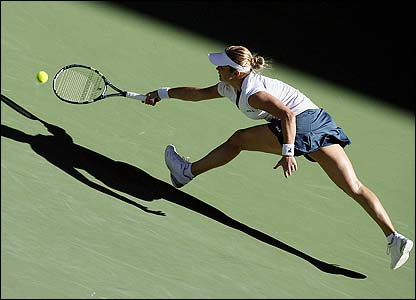 Kim Clijsters stretches for the ball