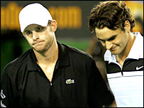 Andy Roddick (left) and Roger Federer after the world number one's crushing win