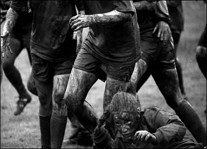 Muddy ladies rugby player