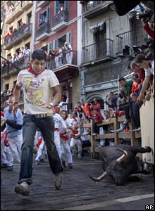 A reveller is chased by a Marques de Domeq's fighting bull during the San Fermin fiestas in Pamplona, northern Spain