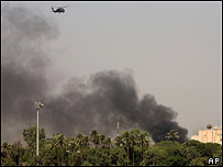 Smoke rises after an attack on Baghdad's fortified Green Zone, site of the parliament