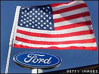 Ford logo under a fluttering US flag