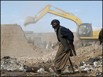Afghan man walks past building work in Kabul