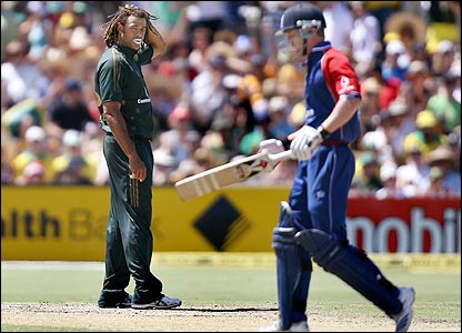 Andrew Symonds looks on as Paul Collingwood walks back to the pavilion