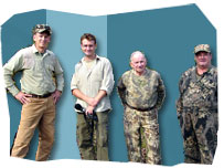 Presenter Nicholas Walton with mic in hand in the middle with some hunters from America