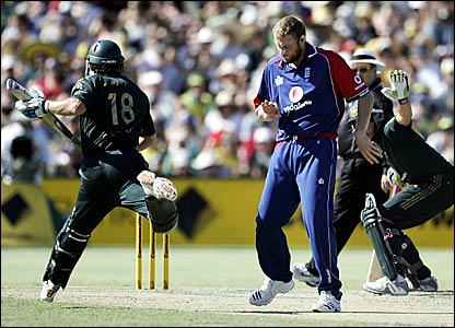 Adam Gilchrist (left) is sent back by Matthew Hayden (right) and run out, while Andrew Flintoff checks out a damaged finger
