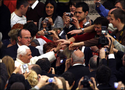 Pope Benedict XVI greets faithful as he arrives in the Paul VI Hall for his weekly general audience