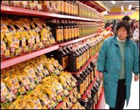 Woman looking for soy sauce in the Beijing Tesco's