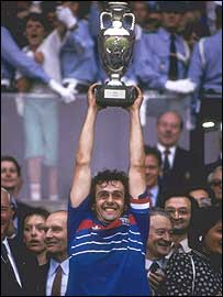 Michel Platini lifts the European Championship trophy as France captain in 1984