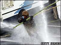 The jet from a police water cannon hits a South Korean demonstrator, December 2006