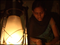Trupti Yashwant Rao studying by candlelight